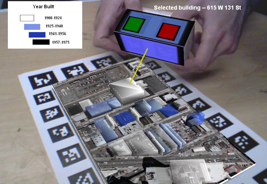 Buildings overlaid on tracked image of urban site are selected using a two-handed controller created from a hand-held box covered with tracker markers