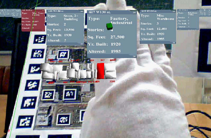 Tracked finger selects from fisheye menu of buildings