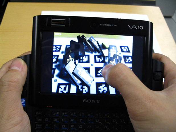 Goblin XNA Domino Knockdown running on a Sony UMPC. The user has just fired a ball at a collection of falling dominoes.