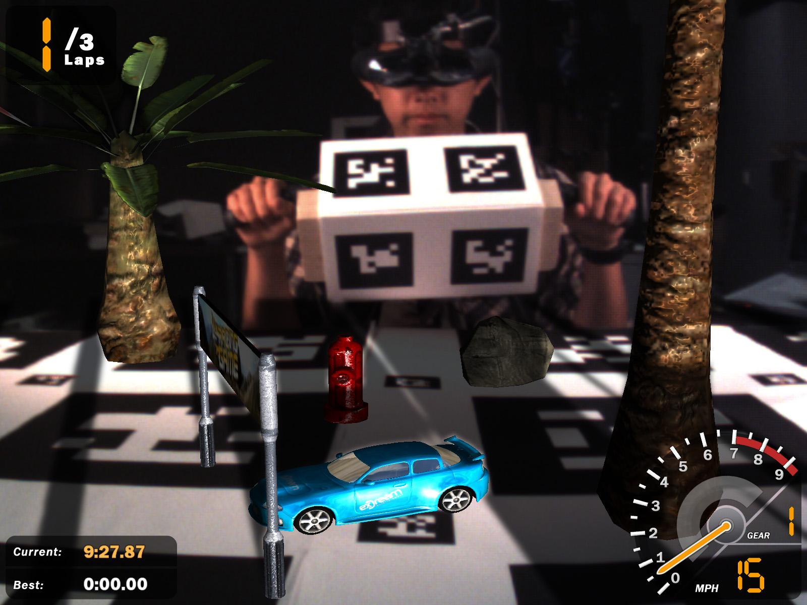 XNA Racing Game screenshot showing player holding driving controller with overlaid virtual objects on physical gameboard